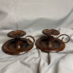 Set of two metal candle holders with handle.